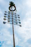 Traditional Maypole. OSTFILDERN-SCHARNHAUSEN, GERMANY - MAY 1, 2014 - A newly decorated and mounted maypole with plaques representing the various professions and Royalty Free Stock Images