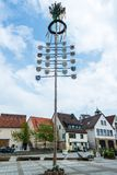 Traditional Maypole. OSTFILDERN-SCHARNHAUSEN, GERMANY - MAY 1, 2014 - A newly decorated and mounted maypole with plaques representing the various professions and Stock Photo