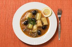Traditional meal. Delicious meal, traditional, whit leek and olives Royalty Free Stock Images