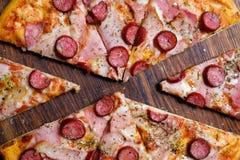 Traditional meal italian food pizza slice ham. Traditional meal. italian food cuisine. delicious pizza slice ham prosciutto and pepperoni stock photos