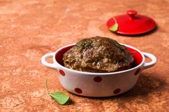 Traditional meatloaf with spices. And vegetables on the table. Selective focus Royalty Free Stock Image