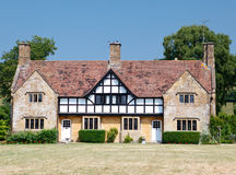 Traditional medieval english mansion built in tudor style Royalty Free Stock Image