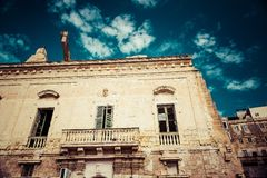 Traditional medieval house in Malta. Traditional medieval dilapidated  house with  in Malta Royalty Free Stock Photo