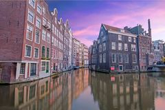 Traditional medieval houses in Amsterdam the Netherlands. At sunset Royalty Free Stock Images