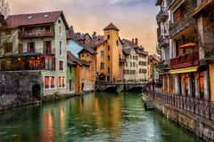 Annecy medieval Old Town, Savoy, France. Traditional medieval houses on a Thiou river in historical Old Town of Annecy, Savoy, France, in dramatic sunset light Royalty Free Stock Photos