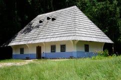 Traditional medieval Ukrainian wattle and daub house, Pirogovo. Traditional medieval Ukrainian wattle and daub house with hay roof in Pirogovo park,Ukraine Royalty Free Stock Photography