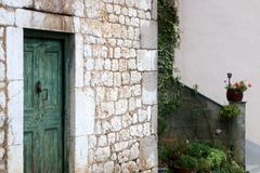 Traditional Mediterranean Architecture. Wood and stone details on an old traditional mediterranean house. Selective focus royalty free stock photography