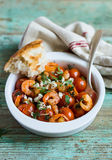 Traditional mediterranean dish with roasted cherry tomatoes, shrimps Stock Photos