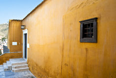Traditional Mediterranean house. Painted in ocher Stock Photos