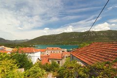 Traditional Mediterranean houses with red tiled roofs and Adriatic Sea, Dalmatia, Croatia Stock Photo