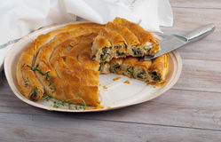 Traditional Mediterranean Pie, with spinach and cheese. Stock Photo