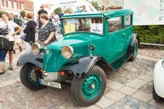 Traditional meeting of fans of vintage cars and motorbikes. An exhibition of old cars in the town square of Tisnov Stock Photo