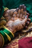 Traditional mehendi henna decoration. A woman is decorated with traditional henna mehendi designs during a Hindu wedding celebration stock photos