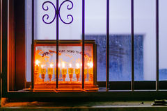 Traditional Menorah (Hanukkah Lamp) with olive oil candles Royalty Free Stock Photography