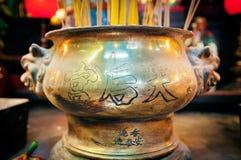 Traditional metal incense burner inside Tin Hau Temple in Yaumatei, Kowloon. Royalty Free Stock Photo