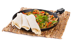 Traditional mexican beef fajitas with tortillas. On white background Royalty Free Stock Photo