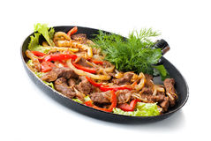 Traditional mexican beef fajitas. On white background Royalty Free Stock Images