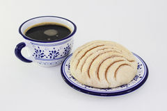 Traditional mexican bread and coffee. A traditional mexican breakfast with concha bread and black coffee in traditional talavera pottery Stock Image