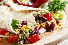 Traditional Mexican burritos with meat and beans, selective focus stock photography