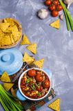 Traditional Mexican chili concarne. Traditional Mexican chili con carne on the table with vegetables and nachos. Selective focus Royalty Free Stock Photos