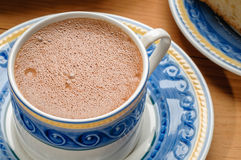 Traditional mexican chocolate cup. Made with cinnamon beaten with wooden utensil called molinillo Royalty Free Stock Photography