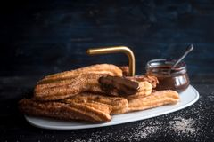 Traditional Mexican dessert churros Stock Photos