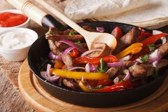 Traditional Mexican fajitas close up on the table. Horizontal Royalty Free Stock Image