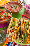 Traditional Mexican Food. Table Layed out with Traditional Mexican Food: Tacos, Salsas, Tortilla Chips Stock Images