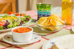 Traditional mexican food with a bowl of nachos, spicy sauce, a p Royalty Free Stock Image