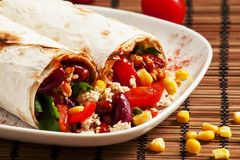 Traditional Mexican food, burritos with meat and beans, selective focus royalty free stock images