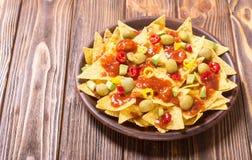 Nachos with sauce salsa. Traditional mexican food . Nachos with sauce salsa , olives , chili peppers and avocado stock photography