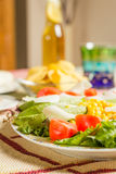 Traditional mexican food with a plate of fresh salad and a bowl stock photography