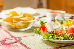 Traditional mexican food with a plate of fresh salad, tortillas, Stock Image
