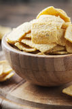 Traditional mexican mais chips on the wooden table Stock Image