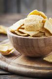Traditional mexican mais chips on the wooden table Royalty Free Stock Photos
