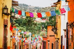 Traditional mexican paper for decoration in streets in Mexico. Vacations in colonial city royalty free stock photo