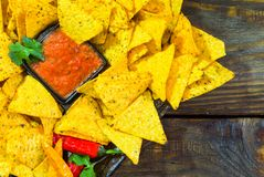 Nachos top view with Tortilla chips tomato salsa and mustard on rustic wooden background. A textured background.Copy paste place Royalty Free Stock Images