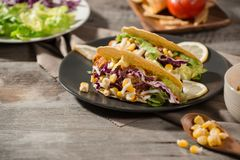 Traditional mexican taco with chicken and vegetables on wooden table. Latin american food.  royalty free stock photos