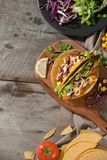 Traditional mexican taco with chicken and vegetables on wooden table. Latin american food.  stock images