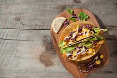 Traditional mexican taco with chicken and vegetables on wooden table. Latin american food.  stock photos
