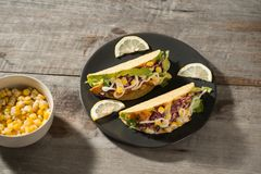Traditional mexican taco with chicken and vegetables on wooden table. Latin american food.  royalty free stock images