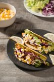 Traditional mexican taco with chicken and vegetables on wooden table. Latin american food.  stock photo