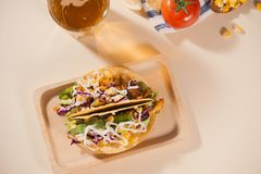 Traditional mexican taco with meat and vegetables. Latin american food.  stock photos