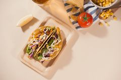 Traditional mexican taco with meat and vegetables. Latin american food.  royalty free stock image