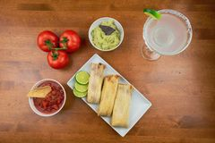 Traditional mexican tamales and salsa. Traditional mexican tamales and margarita for Cinco de Mayo