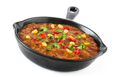Traditional mexican tex mex chili con carne in a frying pan isolated Royalty Free Stock Images