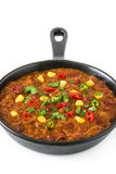 Traditional mexican tex mex chili con carne in a frying pan isolated Royalty Free Stock Image