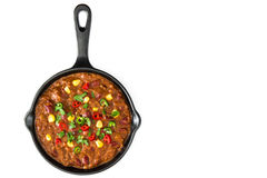 Traditional mexican tex mex chili con carne in a frying pan isolated Stock Images