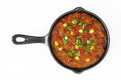 Traditional mexican tex mex chili con carne in a frying pan isolated Stock Photos