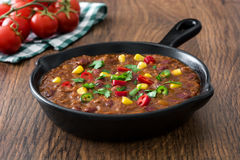 Traditional mexican tex mex chili con carne in a frying pan on wood Stock Photo